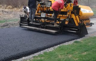 Paving Contractor Paving a Driveway