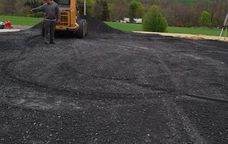 Pre-paving asphalt placing