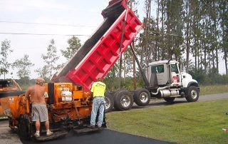 Red Diehl Paving truck dumping