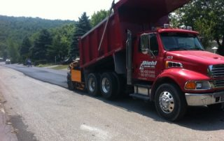 Red Diehl Paving truck