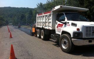 White Diehl Paving truck paving