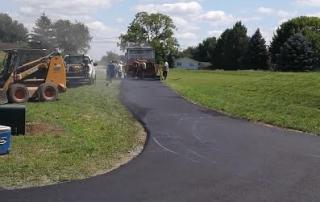 men paving driveway