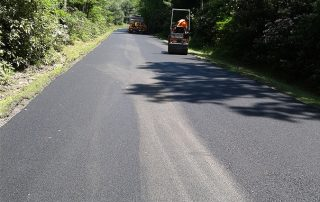 man paving road