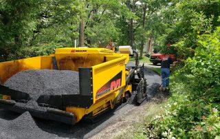 yellow asphalt paver